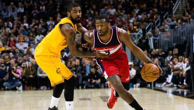 Washington's John Wall drives against Cleveland's Kyrie Irving.