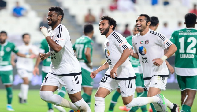 Jazira players celebrate Fares Juma's (l) goal v Shabab