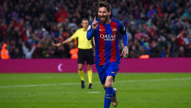 All smiles: Messi scored two against Sevilla on Wednesday night.