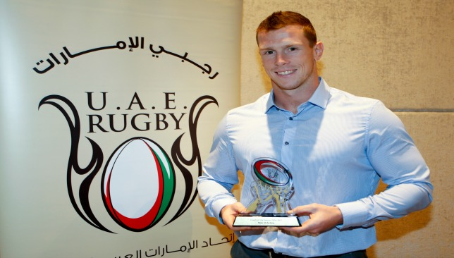 Abu Dhabi Harlequins' Mike McFarlane collects his Coach of the Year award