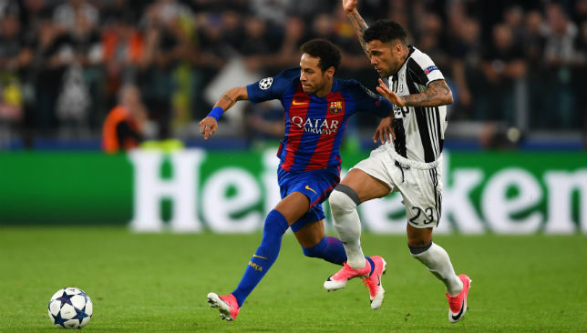Neymar runs past Dani Alves.