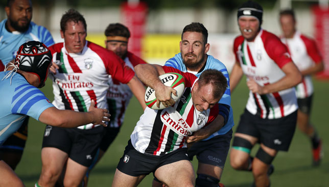 UAE's Kris Greene takes the ball on during their match against the Barbarians.