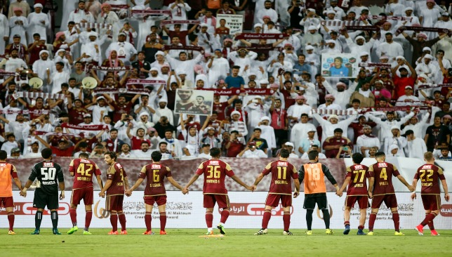 Al Whada players celebrate in front of their supporters