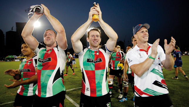 Abu Dhabi Harlequins coach Mike McFarlane (r) leads the Barbarians.