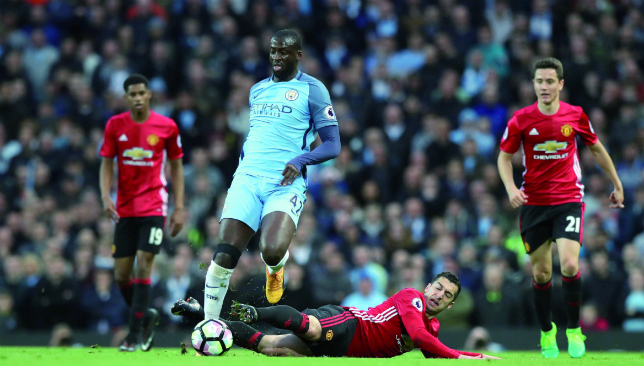 On the charge: Manchester City's Yaya Toure against United (Getty).