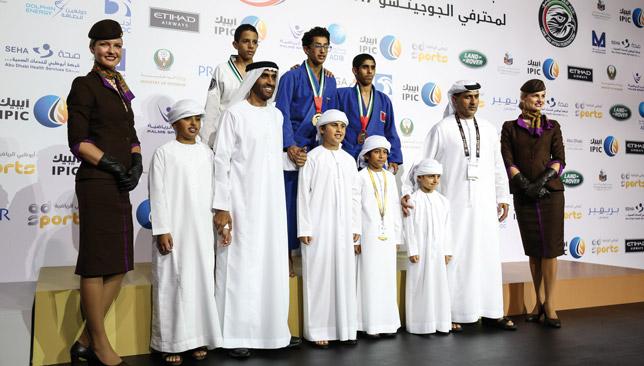 Sheikh Nahyan bin Zayed Al Nahyan (third l) with medalists at the Abu Dhabi World Pro Jiu-Jitsu Championship.