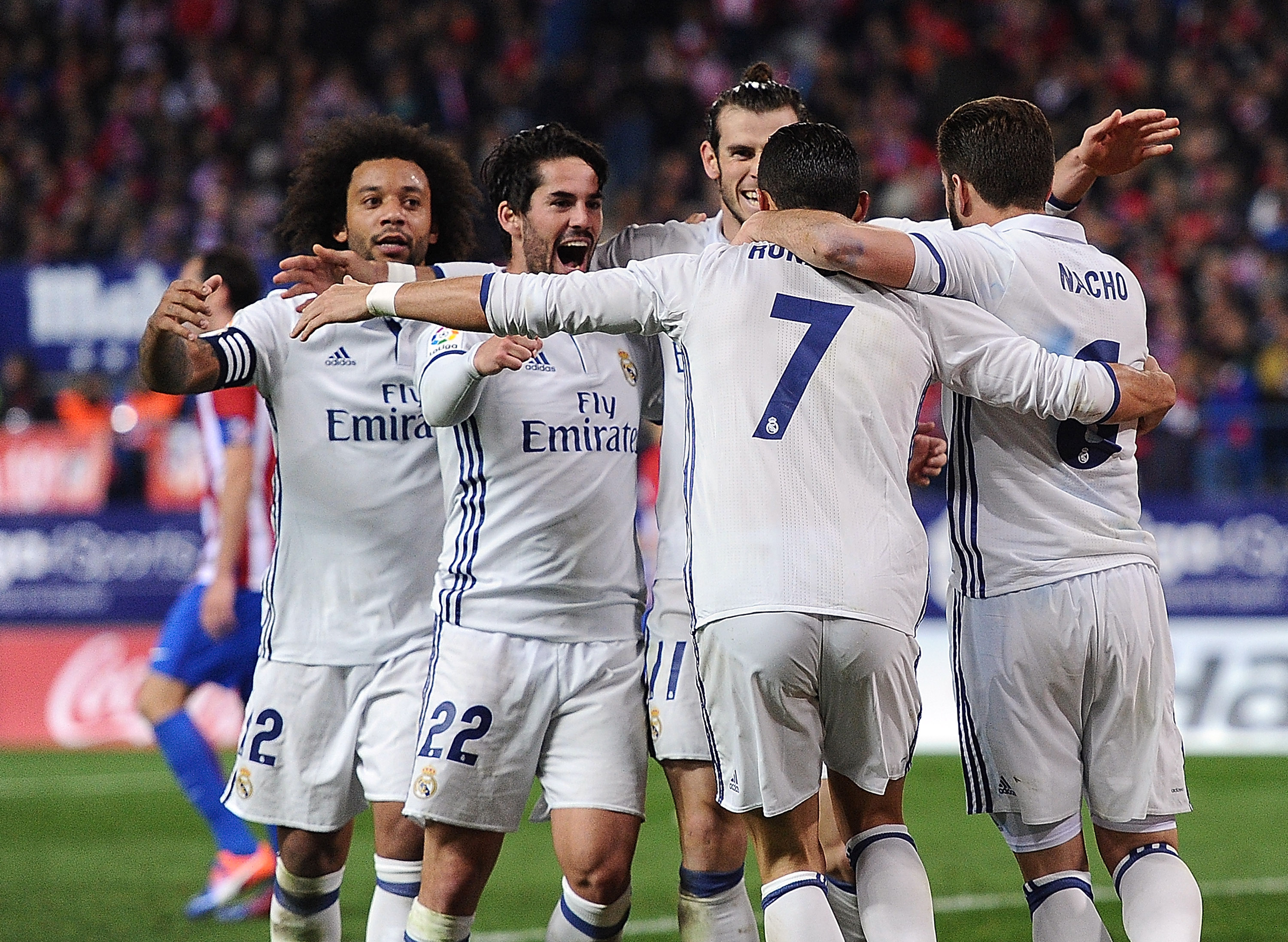 MADRID, SPAIN - NOVEMBER 19: Cristiano Ronaldo of Real Madrid celebrates with teammates after scoring Real's 3rd goal during the La Liga match between Club Atletico de Madrid and Real Madrid CF at Vicente Calderon Stadium on November 19, 2016 in Madrid, Spain. (Photo by Denis Doyle/Getty Images)