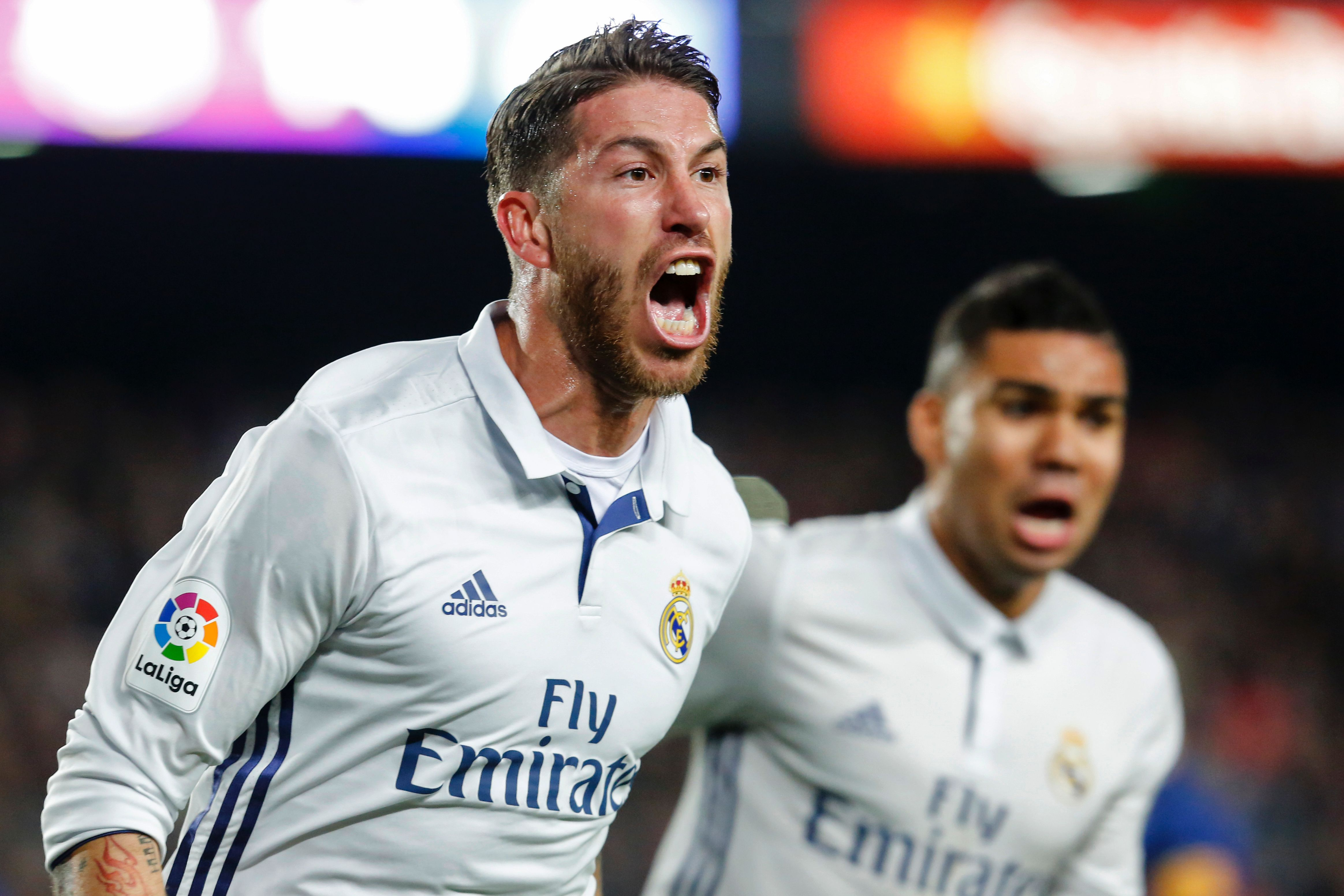 Real Madrid's defender Sergio Ramos celebrates after scoring the equalizer during the Spanish league football match FC Barcelona vs Real Madrid CF at the Camp Nou stadium in Barcelona on December 3, 2016. / AFP / PAU BARRENA (Photo credit should read PAU BARRENA/AFP/Getty Images)