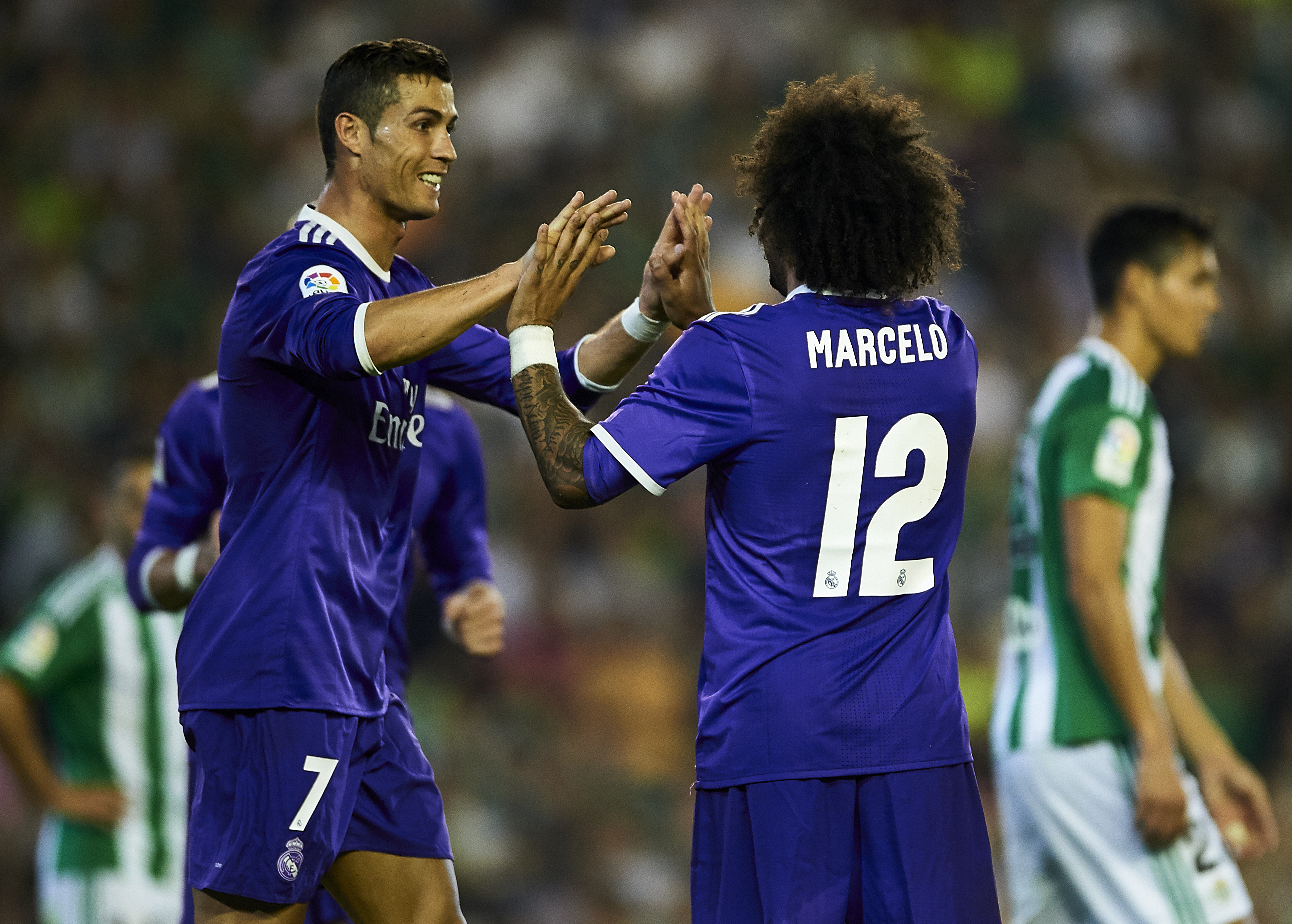 SEVILLE, SPAIN - OCTOBER 15: Marcelo (R) and Cristiano Ronaldo of Real Madrid CF celebrates after scoring during the match between Real Betis Balompie and Real Madrid CF as part of La Liga at Benito Villamrin stadium October 15, 2016 in Seville, Spain. (Photo by Aitor Alcalde/Getty Images)