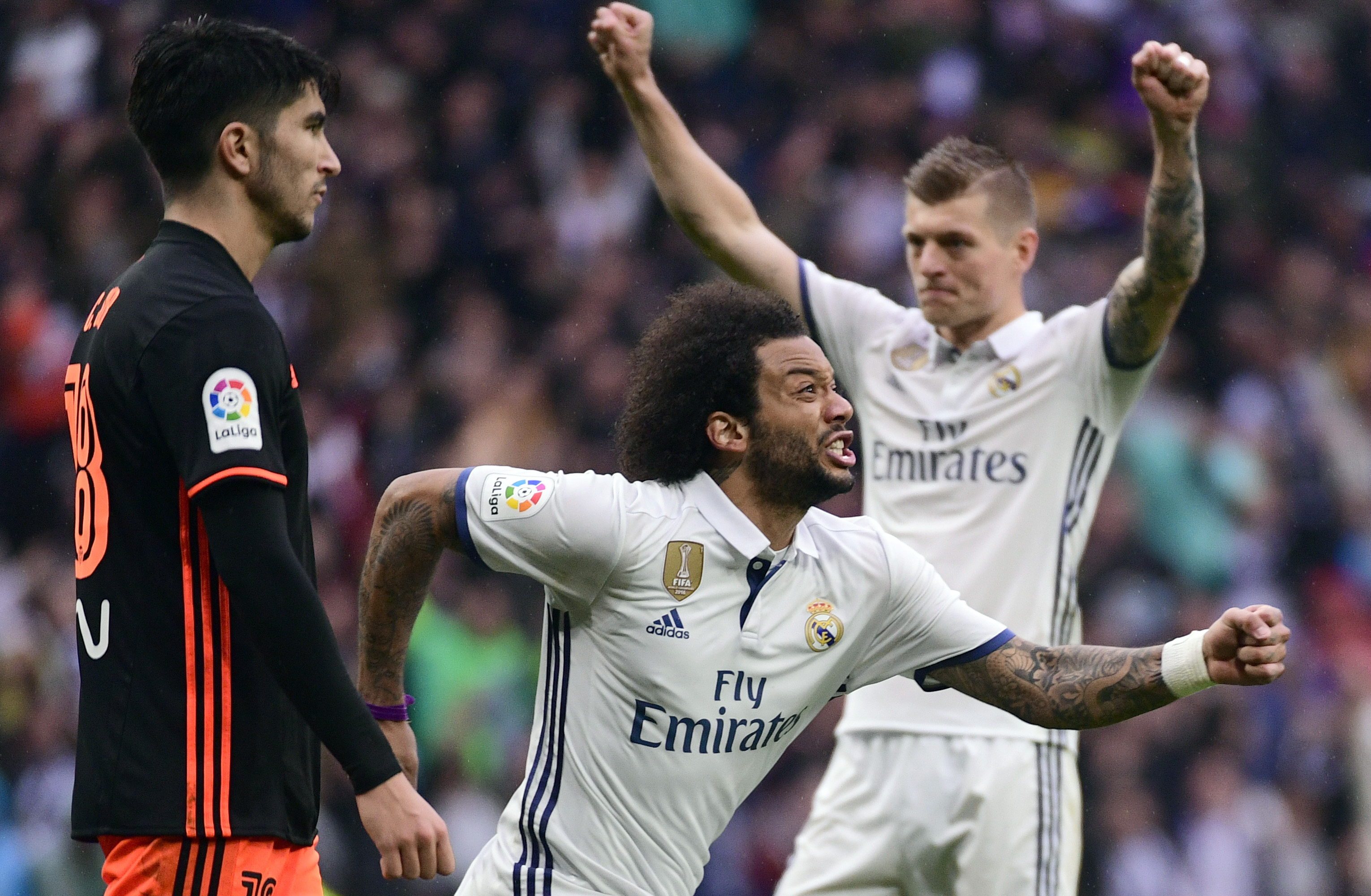 TOPSHOT - Real Madrid's Brazilian defender Marcelo (C) celebrates a goal during the Spanish league football match Real Madrid CF vs Valencia CF at the Santiago Bernabeu stadium in Madrid on April 29, 2017. / AFP PHOTO / PIERRE-PHILIPPE MARCOU (Photo credit should read PIERRE-PHILIPPE MARCOU/AFP/Getty Images)
