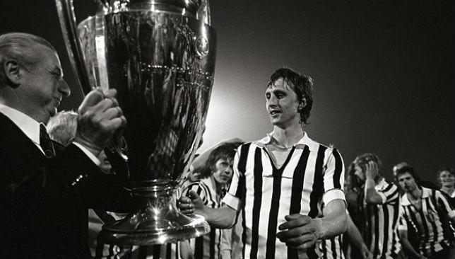 Cruyff lifts the trophy, yet again.