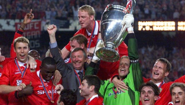 Manchester United coach Alex Ferguson and players celebrate a memorable comeback win.