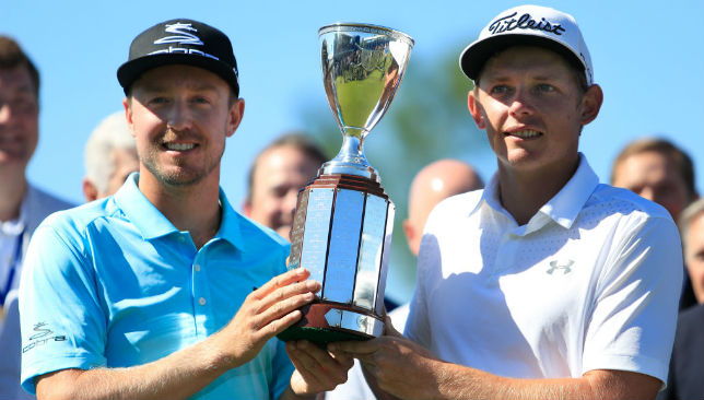 Jonas Blixt and Cameron Smith pose with the trophy at the Zurich Classic.