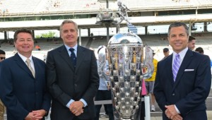 Scott Goodyear (far left) and Eddie Cheever (pictured left of Indy 500 trophy).