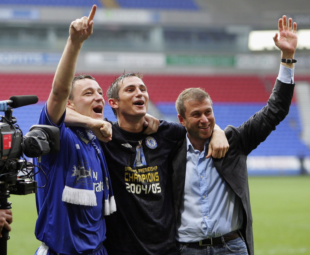 BOLTON, ENGLAND - APRIL 30: Frank Lampard, John Terry and Chairman, Roman Abramovich of Chelsea celebrate winning the Premiership after victory over Bolton Wanderers in the Barclays Premiership match between Bolton Wanderers and Chelsea at the Reebok Stadium on April 30, 2005 in Bolton, England. (Photo by Alex Livesey/Getty Images)