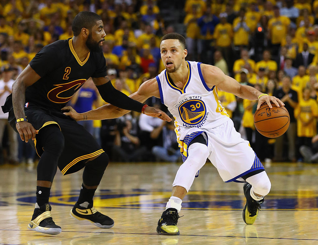 OAKLAND, CA - JUNE 19: Stephen Curry #30 of the Golden State Warriors handles the ball against Kyrie Irving #2 of the Cleveland Cavaliers during the second half in Game 7 of the 2016 NBA Finals at ORACLE Arena on June 19, 2016 in Oakland, California. NOTE TO USER: User expressly acknowledges and agrees that, by downloading and or using this photograph, User is consenting to the terms and conditions of the Getty Images License Agreement. (Photo by Ezra Shaw/Getty Images)