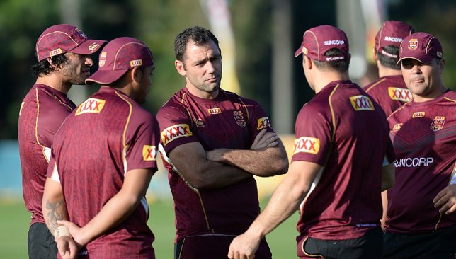 Cameron Smith and team mates talk tactics during training.