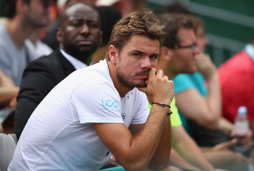 Wawrinka watching his girlfriend Donna Vekic's match at Roland Garros on Monday.