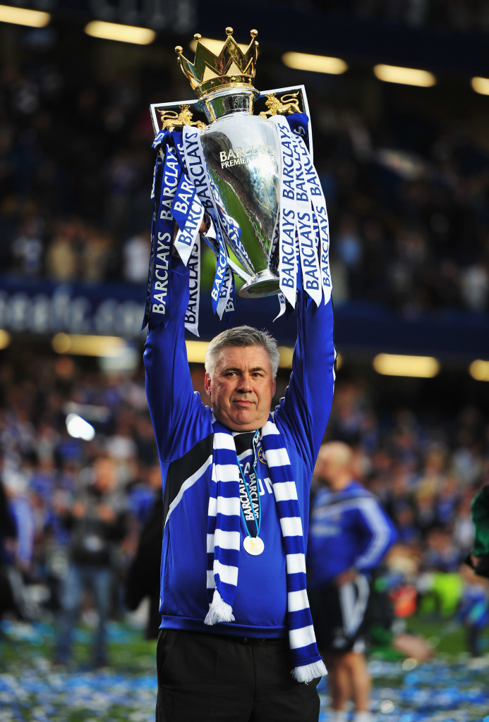 LONDON, ENGLAND - MAY 09: Carlo Ancelotti manager of Chelsea celebrates with the trophy as they win the title after the Barclays Premier League match between Chelsea and Wigan Athletic at Stamford Bridge on May 9, 2010 in London, England. Chelsea won 8-0 to win the championship. (Photo by Clive Mason/Getty Images)