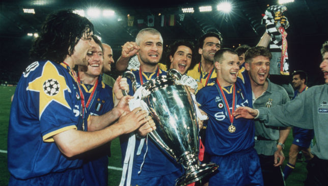 Juventus captain Gianluca Vialli (C) holds the cup after beating Ajax on penalties.