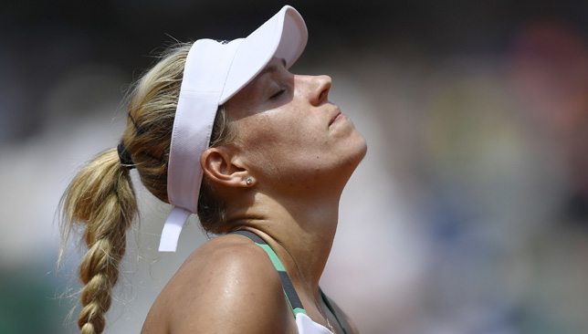 Seeded Angelique Kerber upset in first round