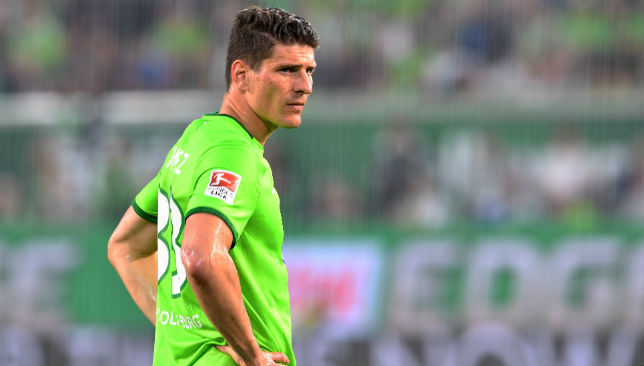 Wolfsburg forward Mario Gomez looks on.