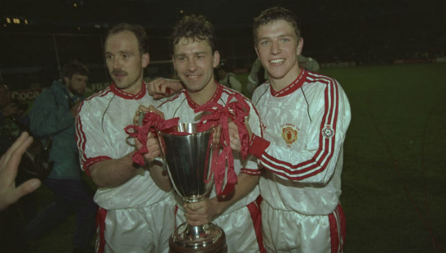 Sharpe (r) celebrates United's 1991 UEFA Cup Winners' Cup win with Mike Phelan and Bryan Robson.