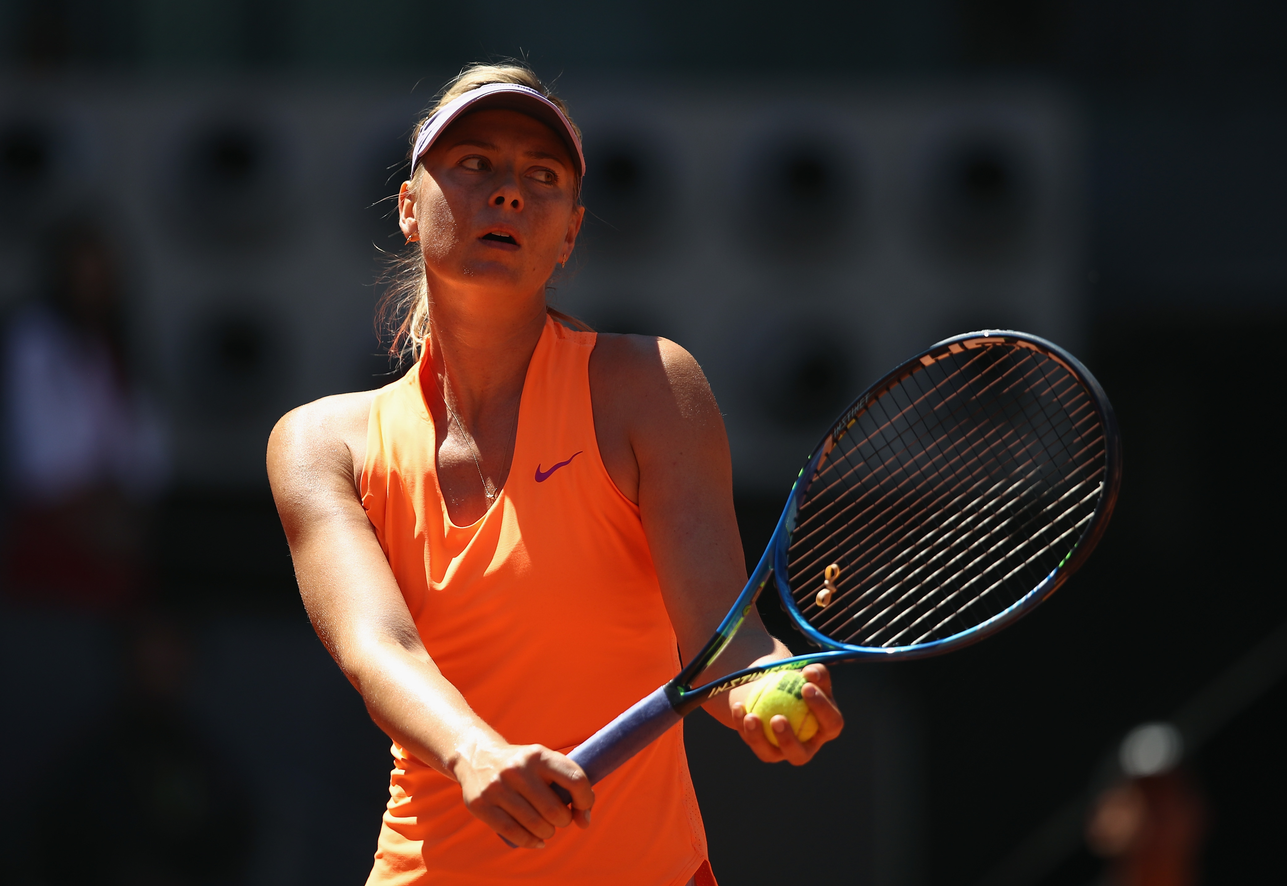 Rolling on: Sharapova moves into the second round in Madrid.