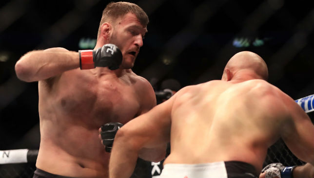 Hands up: Stipe Miocic (L) lets fly at Junior Dos Santos in their UFC heavyweight championship fight at the American Airlines Center in Dallas.