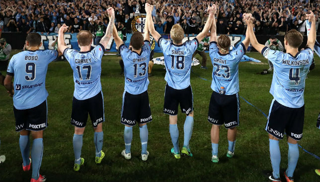 Sydney FC players celebrate their semi-final victory over Perth Glory.