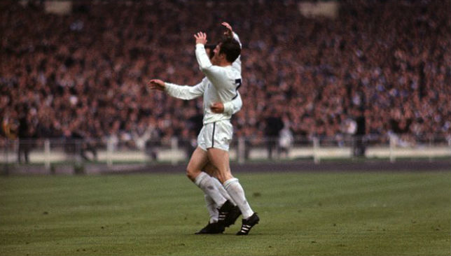 Tottenham's Jimmy Robertson celebrates with Jimmy Greaves.