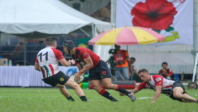 The UAE's Sean Carey (l) and Ryno Fourie close down a Malaysia opponent