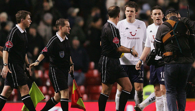 Robbie Keane (R) and Michael Carrick of Tottenham protest at the final whistle to referee Mark Clattenburg after a goal was disallowed.