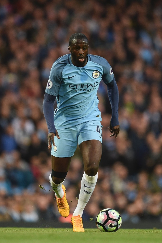 Manchester City's Ivorian midfielder Yaya Toure runs with the ball during the English Premier League football match between Manchester City and Manchester United at the Etihad Stadium in Manchester, north west England, on April 27, 2017. / AFP PHOTO / Oli SCARFF / RESTRICTED TO EDITORIAL USE. No use with unauthorized audio, video, data, fixture lists, club/league logos or 'live' services. Online in-match use limited to 75 images, no video emulation. No use in betting, games or single club/league/player publications. / (Photo credit should read OLI SCARFF/AFP/Getty Images)