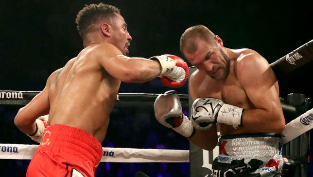 Andre Ward (L) and Sergey Kovalev battle it out during their light heavyweight championship bout.