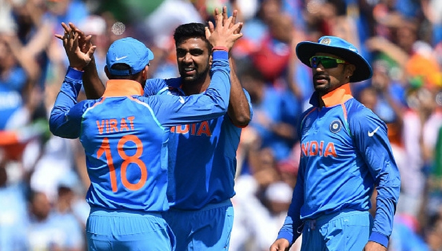 Ashwin (C) celebrates the wicket of Amla with Kohli (L) and Dhawan (R) [Getty Images]