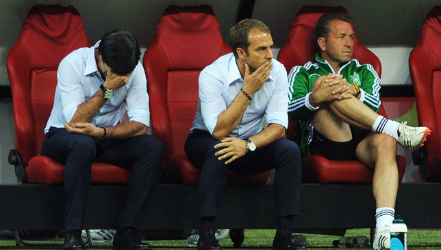 Joachim Loew (L) show his dejection after losing to Italy.