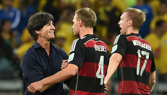 Joachim Loew congratulates Benedikt Hoewedes and Per Mertesacker after their convincing win over Brazil.