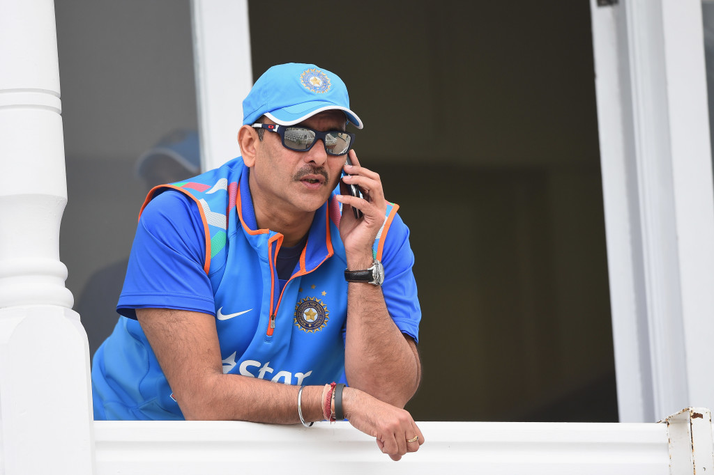 NOTTINGHAM, ENGLAND - AUGUST 29: Ravi Shastri of India speaks on the phone during net practice at Trent Bridge on August 29, 2014 in Nottingham, England. (Photo by Laurence Griffiths/Getty Images)
