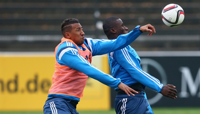 Rudiger competes for a ball with Boateng at training.