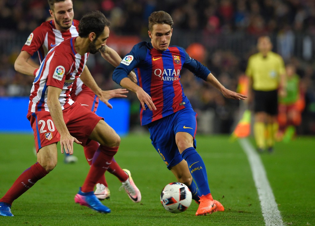 Barcelona's midfielder Denis Suarez (R) vies with Atletico Madrid's defender Juanfran during the Spanish Copa del Rey (King's Cup) semi final second leg football match FC Barcelona vs Club Atletico de Madrid at the Camp Nou stadium in Barcelona on February 7, 2017. / AFP / LLUIS GENE (Photo credit should read LLUIS GENE/AFP/Getty Images)