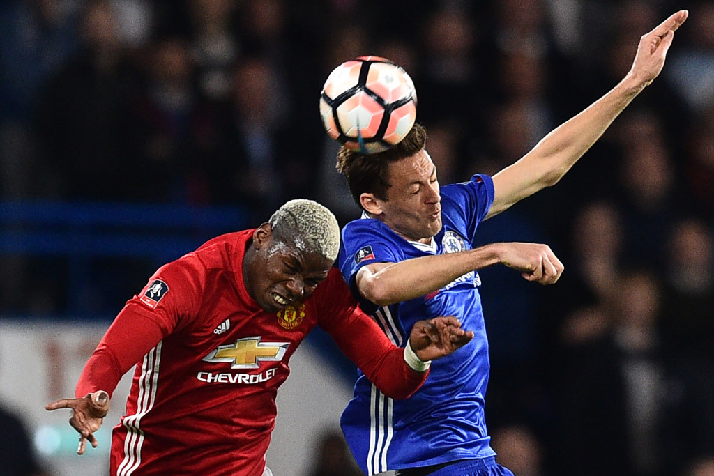 TOPSHOT - Chelsea's Serbian midfielder Nemanja Matic (R) vies with Manchester United's French midfielder Paul Pogba during the English FA Cup quarter final football match between Chelsea and Manchester United at Stamford Bridge in London on March 13, 2017. / AFP PHOTO / Glyn KIRK / RESTRICTED TO EDITORIAL USE. No use with unauthorized audio, video, data, fixture lists, club/league logos or 'live' services. Online in-match use limited to 75 images, no video emulation. No use in betting, games or single club/league/player publications. / (Photo credit should read GLYN KIRK/AFP/Getty Images)
