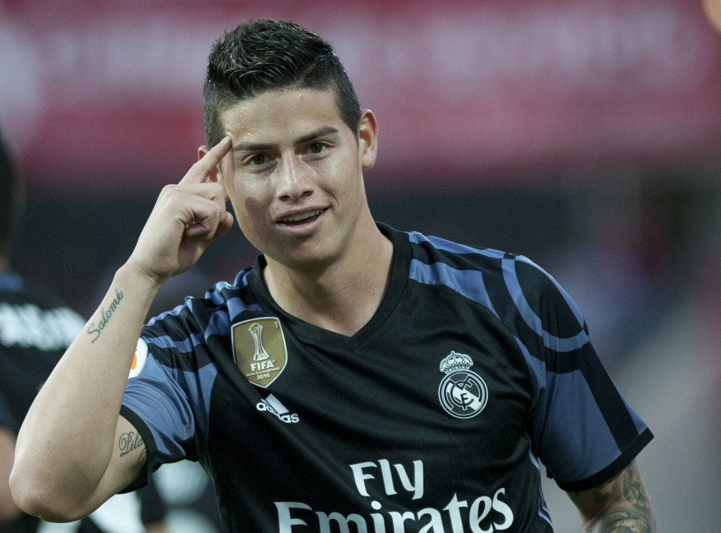 Real Madrid's Colombian midfielder James Rodriguez celebrates after scoring a goal during the Spanish league football match Granada FC vs Real Madrid CF at Nuevo Los Carmenes stadium in Granada on May 6, 2017. / AFP PHOTO / SERGIO CAMACHO (Photo credit should read SERGIO CAMACHO/AFP/Getty Images)