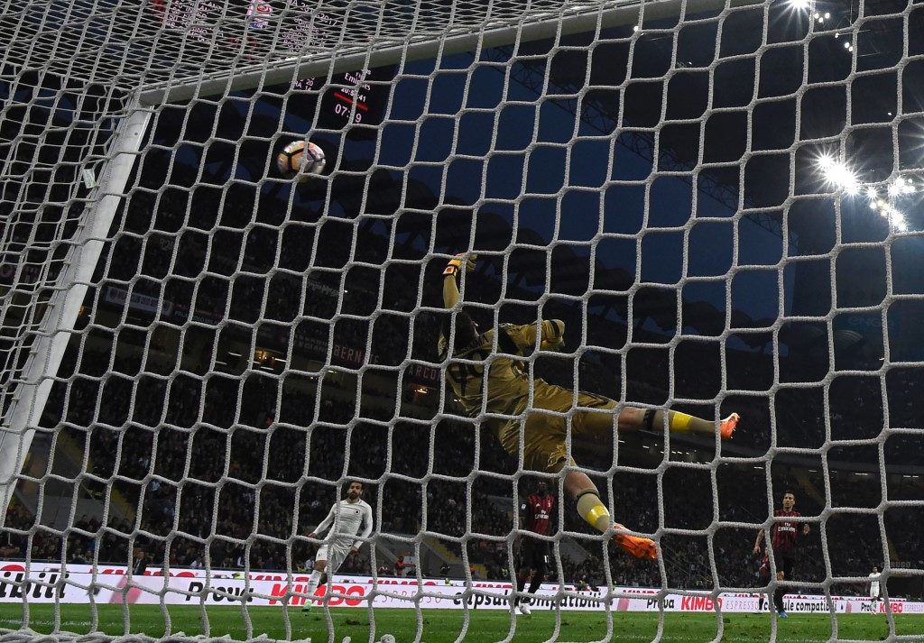 AS Roma's Bosnian forward Edin Dzeko (not seen) scores against AC Milan's goalkeeper Gianluigi Donnarumma during the Italian Serie A football match AC Milan vs AS Roma at the San Siro stadium in Milan on Mai 7, 2017. / AFP PHOTO / MIGUEL MEDINA (Photo credit should read MIGUEL MEDINA/AFP/Getty Images)