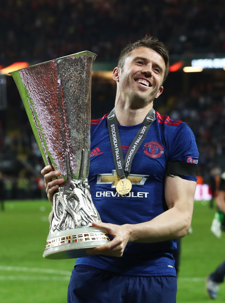 STOCKHOLM, SWEDEN - MAY 24: Michael Carrick of Manchester United celebrates with The Europa League trophy after the UEFA Europa League Final between Ajax and Manchester United at Friends Arena on May 24, 2017 in Stockholm, Sweden. (Photo by Julian Finney/Getty Images)