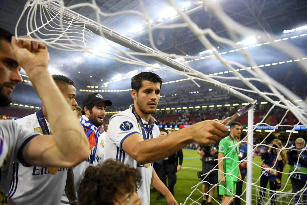 CARDIFF, WALES - JUNE 03: Alvaro Morata of Real Madrid cuts the net after the UEFA Champions League Final between Juventus and Real Madrid at National Stadium of Wales on June 3, 2017 in Cardiff, Wales. (Photo by Shaun Botterill/Getty Images)