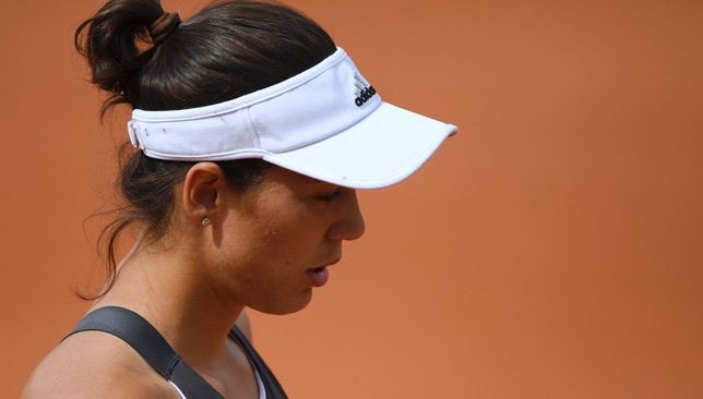 Tearful Muguruza unhappy with crowd as defending champion exits French Open