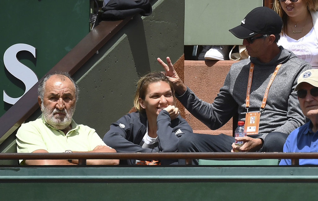 Halep and her coach Cahill with Ion Tiriac the day before the final.