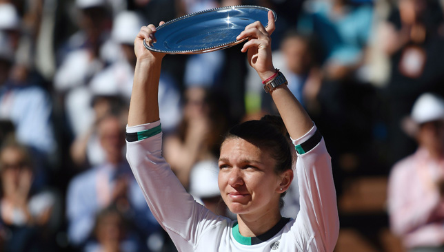 Halep lifts her runner-up trophy in Paris on Saturday.