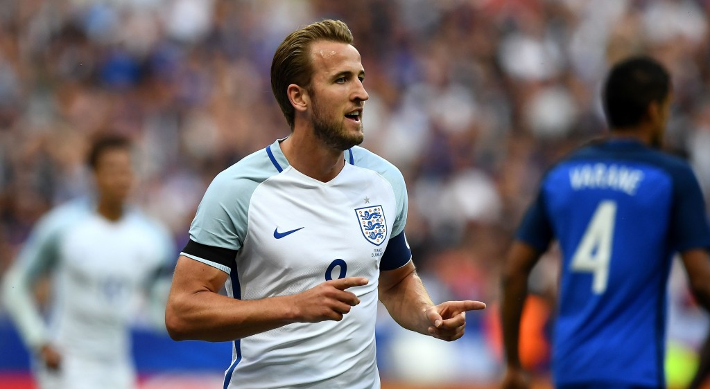 England's forward Harry Kane celebrates after scoring during the international friendly football match between France and England at The Stade de France Stadium in Saint-Denis near Paris on June 13, 2017. / AFP PHOTO / FRANCK FIFE (Photo credit should read FRANCK FIFE/AFP/Getty Images)